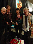 the band with Tom Waits backstage May 6