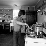 Keith cooking in the kitchen of Andy Warhol's Montauk home where the Rolling Stones were rehearsing for their 1975 Tour of the Americas. © Ken Regan, 1975